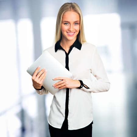 electronic pad: Businesswoman standing in office with electronic pad