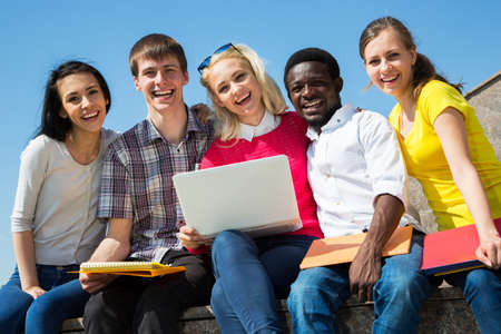 students group: Group of university students studying reviewing homework Stock Photo