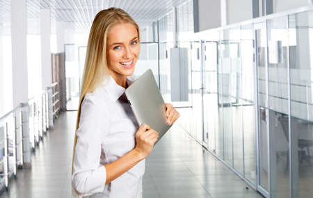 android tablet: Business woman at office with  tablet computer