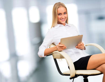 electronic pad: Businesswoman sitting in office with electronic pad