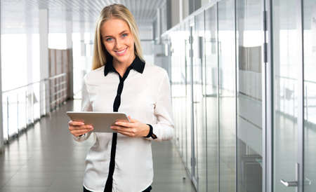 tablet computer: Business woman at office with  tablet computer