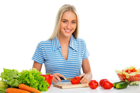 house wife: Young woman cooking  vegetable salad