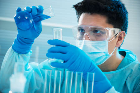 Young medical scientist working in laboratory