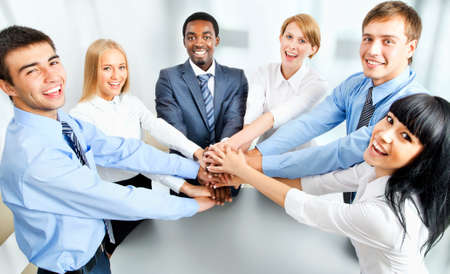 teamwork  together: Business team showing unity with their hands together Stock Photo