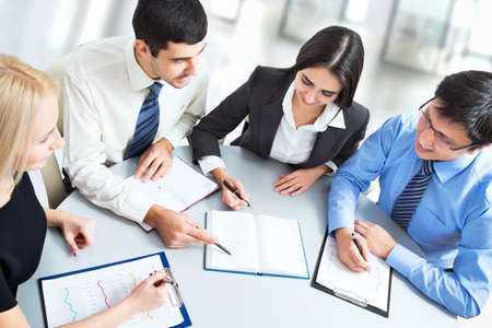 A business team of four plan work in office 스톡 콘텐츠