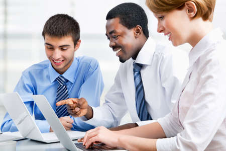 career young: Group of happy business people in a meeting at office