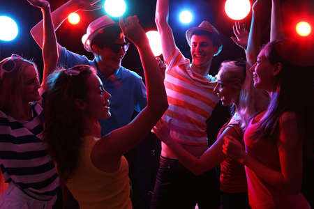christmas fun: Young people having fun dancing at party. Stock Photo