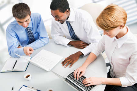 Image of businesspeople working at meeting photo