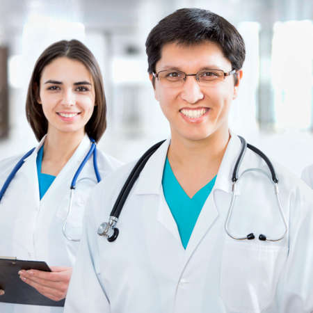 Doctor giving his younger colleague a piece of advice concerning the diagnosis Stock Photo