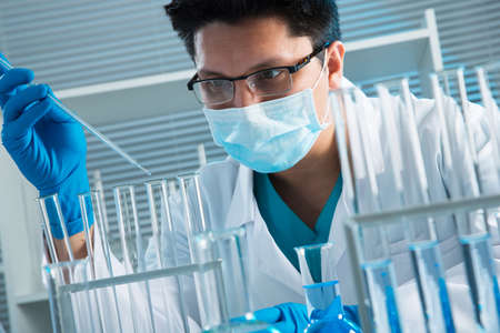 medical laboratory: Young medical scientist working in laboratory