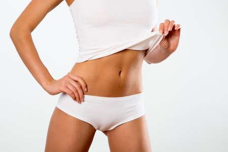 curvas: Hermoso cuerpo delgado de una mujer en ropa interior