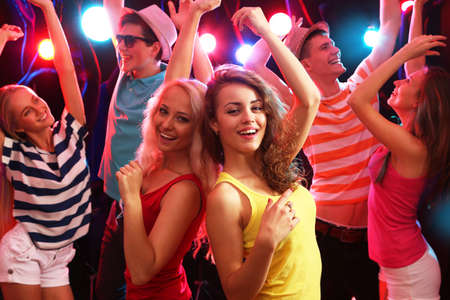 entertainment: Young people having fun dancing at party. Stock Photo