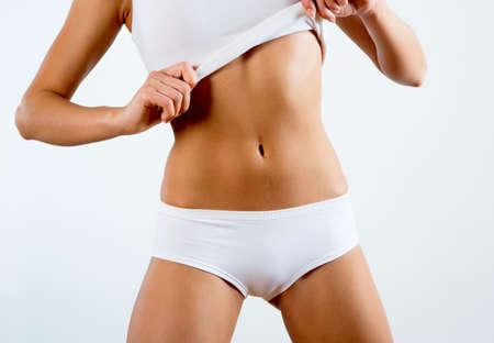 beautiful body: Beautiful slim body of a woman in lingerie Stock Photo