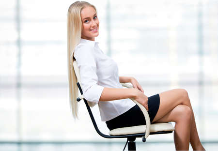 Beautiful business woman sitting at the office
