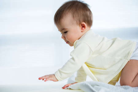 crawling baby: Happy crawling baby. Side view Stock Photo