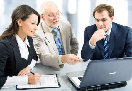 Business people working with lap-top photo