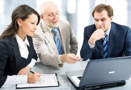 Mensen uit het bedrijfsleven werken met lap-top Stockfoto