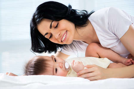 happy mom: Happy mother with adorable baby Stock Photo