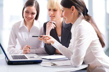 Business women discussing in a meeting photo