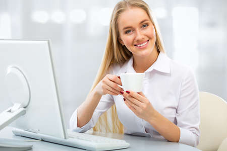 charming woman: Portrait of a young business with cup of coffee