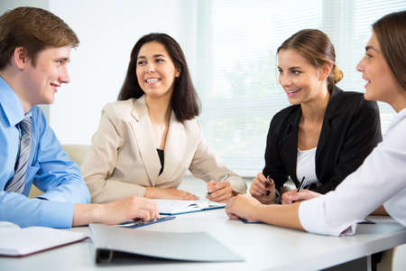 business people meeting: Group of happy businesspeople in a meeting at office Stock Photo