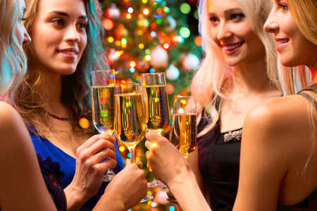 nightclub: Happy young women with glasses of champagne. Xmas Stock Photo