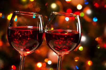 cheers: Crystal glasses of wine on the background of Christmas lights