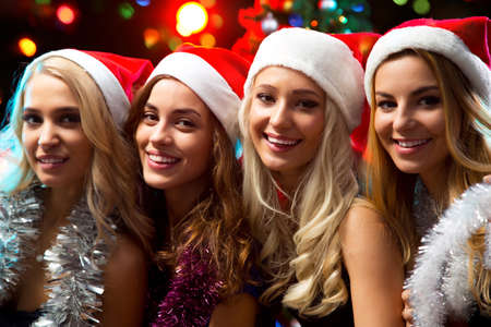 happy christmas: Happy girls at a Christmas party