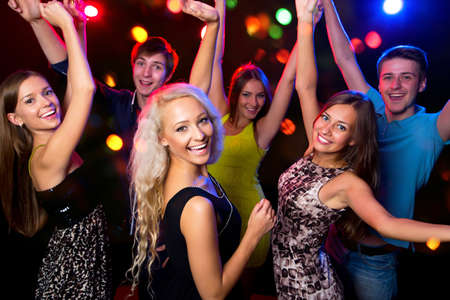 young people fun: Young people having fun dancing at party. Stock Photo