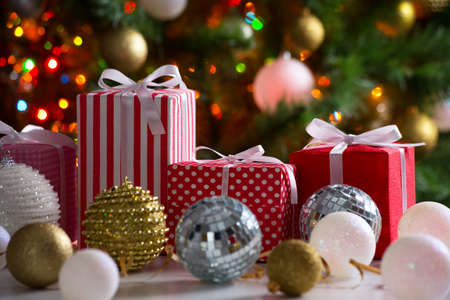 fir tree: Christmas presents and balls against the backdrop of a festive Christmas tree