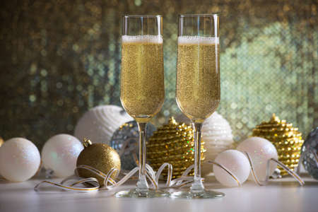 champagne glasses: Two champagne glasses and christmas balls on the background