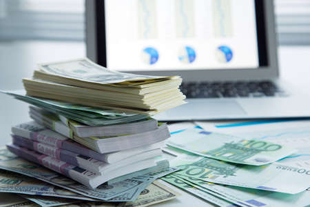 business money: The workplace of business people. Laptop and money. Stock Photo