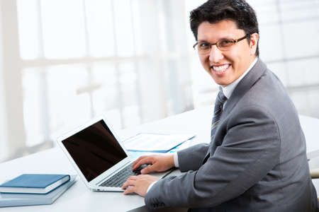 man with laptop: Happy business man sitting in front of laptop