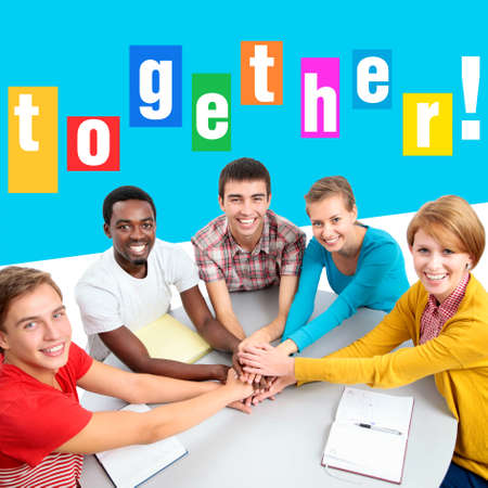 Bright collage of international group of students showing unity with their hands together photo