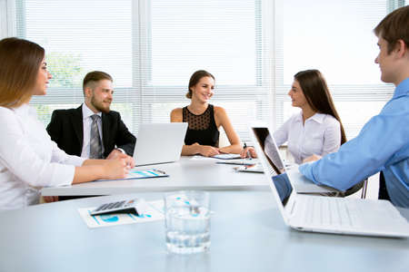 businesspeople: Group of happy businesspeople in a meeting at office Stock Photo