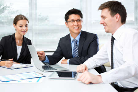 studing: Business people analyzing and discussing during a working meeting in a modern office