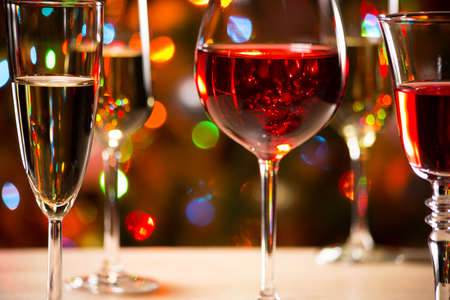 wine glasses: Crystal glasses of wine on the background of Christmas lights
