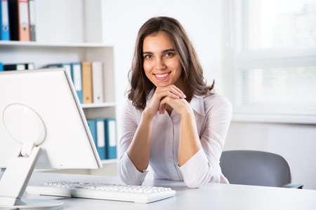 computer isolated: Young business woman with computer in the office