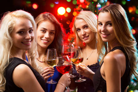 Happy young women with glasses of champagne. X-mas. Stock Photo