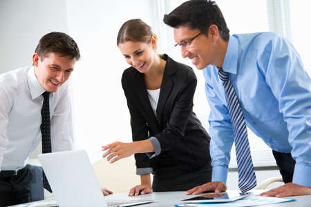 working in office: Business people working with laptop in an office Stock Photo