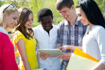 Group of student with notebook outdoor photo