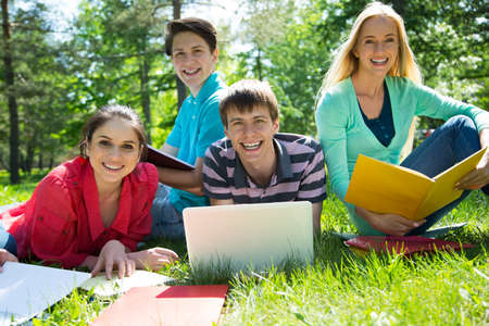 Group of students studying together in campus ground Reklamní fotografie