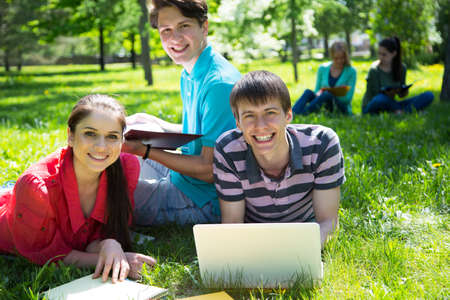 Group of students studying together in campus ground Stock Photo