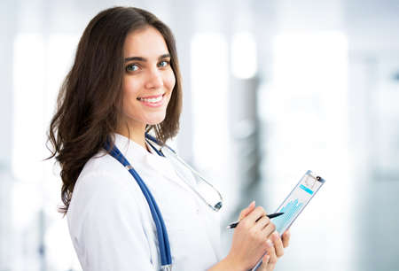 Smiling doctor woman with copy space Stock Photo