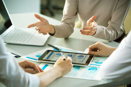Business people working with tablet computer in an office Stock Photo