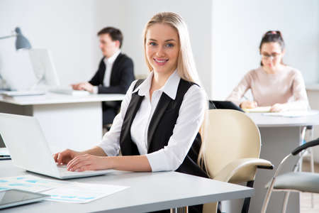 Businesswoman working with computer in an office photo