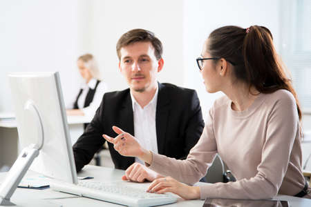 Business people working with computer in an office Stock Photo