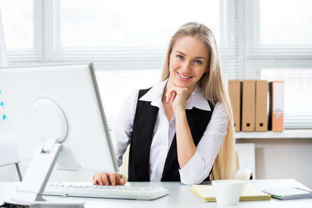 Portrait of a young business woman using computer at office Stock Photo