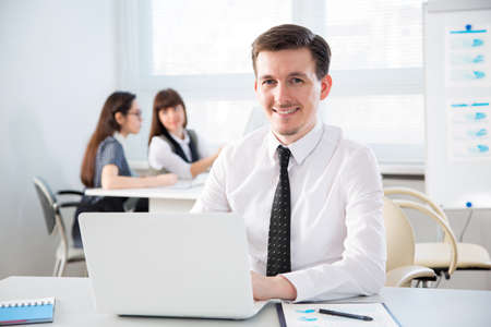 Businessman working with laptop in an office