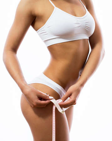Slim beautiful woman with measure
